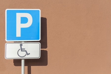 Sign of people with a mobility impairment on parking place