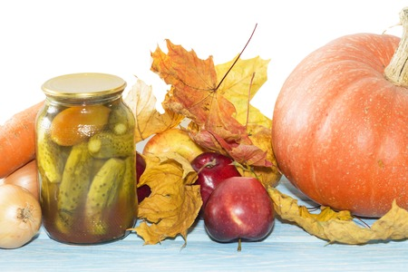Autumn harvest still Life with pumpkins, apples, on wooden background, white background Stock Photo