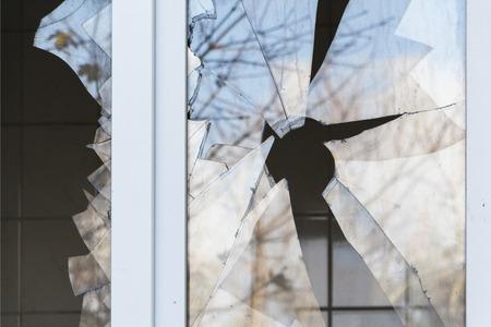broken window in a residential building, hostilities, housing security. Stock fotó
