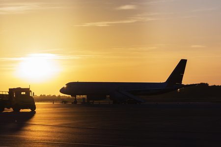 Colorful of sunset in the airport with aeroplane wing, Business and transportation concept