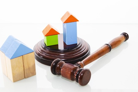 wooden house and judge gavel on a white background. Is isolated Reklamní fotografie