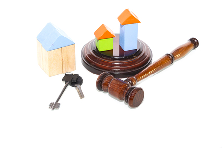 wooden house and judge gavel on a white background. Is isolated.