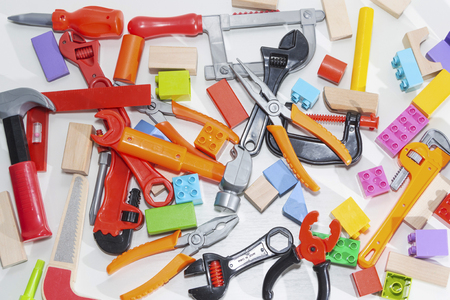 Toy tools and cubes on a light background. Toy for children.