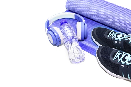 Yoga Mat, sports shoes, water bottle concept of healthy living, healthy eating, sports and diet.