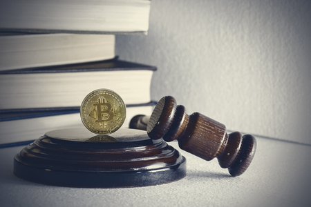 judges hammer and bitcoin gold coin. Digital currency.