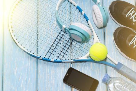 tennis racket. light blue background. sneakers, rocket, ball water bottle music headphones