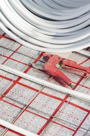 Underfloor heating system in new residential house Imagens