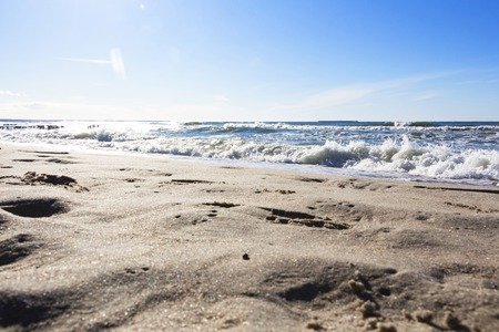 a beautiful wave hits the beach on a sandy beach on a Sunny day.