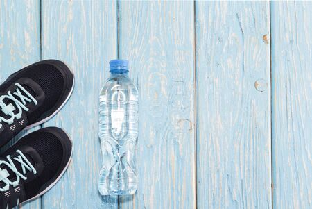 sports shoes, water bottle concept of healthy living, healthy eating, sports and diet.