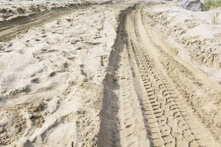 tire tracks in the sand. extreme driving. Stock Photo