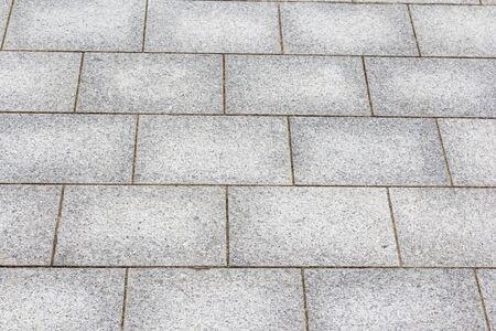 A street pavement of antique rectangular floor tiles