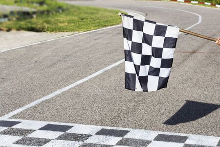 The finish line and checkered flag racing. finish the race. 版權商用圖片