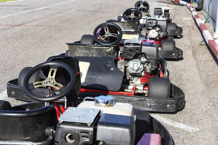 A number of small race cars ready for the race.