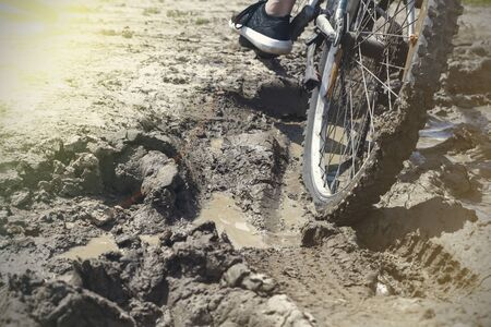 the Bicycle wheel is stuck in the mud. Close up. 스톡 콘텐츠