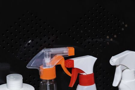 windows cleaning sprays. bottles with sprays for cleaning on the black background