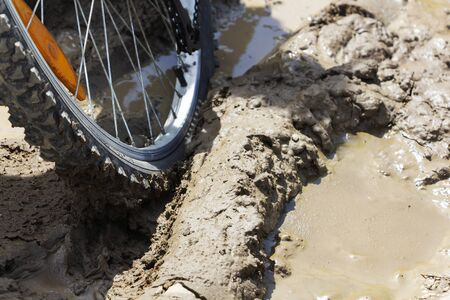 the Bicycle wheel is stuck in the mud. Close up. 스톡 콘텐츠 - 127680147