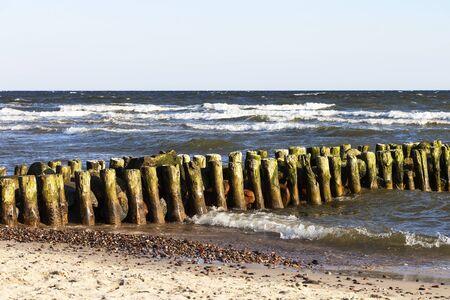 a beautiful wave hits the beach on a sandy beach on a Sunny day