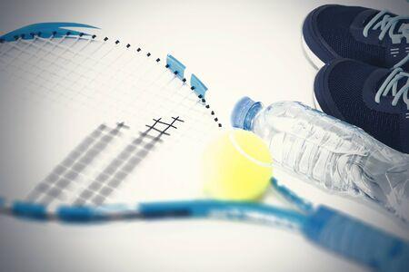 Tennis racket on white background. rocket, ball, water bottle