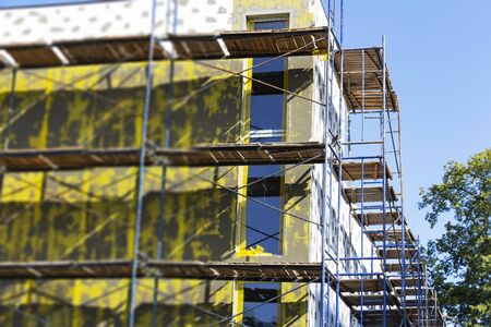 Insulation of walls, installation of scaffolding, high-rise work, energy saving
