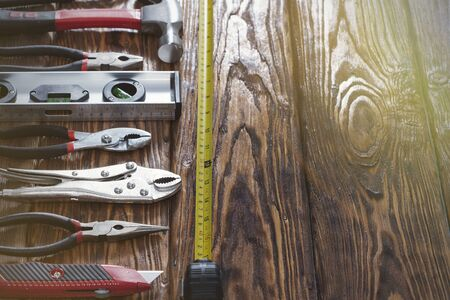 Close up tools on a wooden background