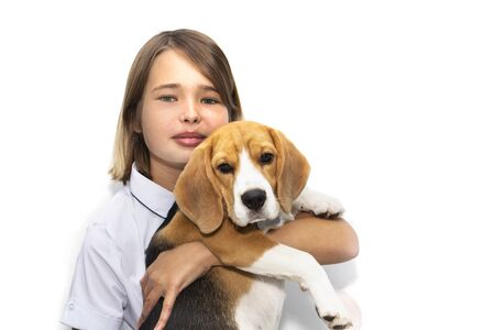 Portrait of a teenage girl with a dog breed Beagle