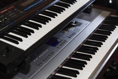 keyboard piano electronic organ close-up. Modern music