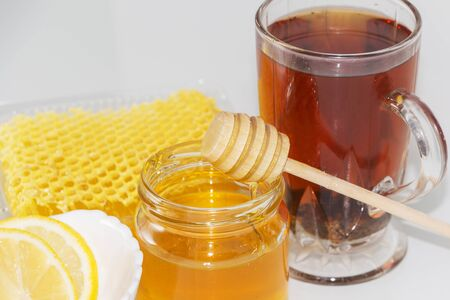 Tea with lemon and honey. The honey in the comb