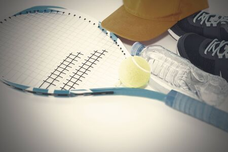 Tennis on a light background. sneakers, tennis racket, ball