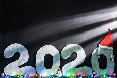 Happy new year 2020 isolated on black background with copy space for text, for holiday card. Blurred snowflakes, snow Stockfoto