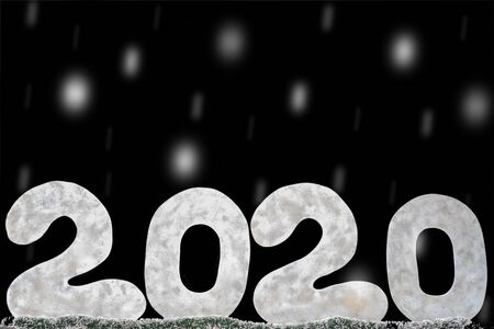 Happy new year 2020 isolated on black background with copy space for text, for holiday card. Blurred snowflakes, snow Stock Photo