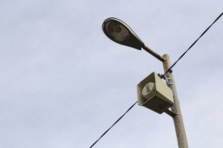a loudspeaker on a street lamp post. The alarm notification