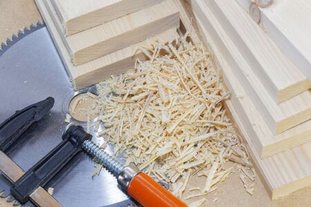 Wooden light boards. Sawdust. Chip. . Space for text Saw blade and clamps Stockfoto