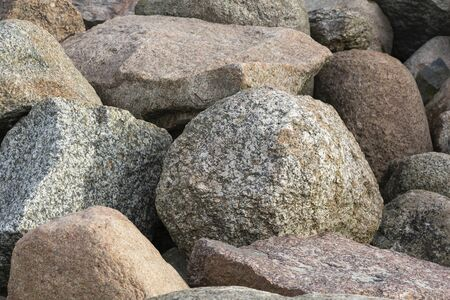 A pile of large gray stones. Many gray stones. The collapse of the stones Stockfoto