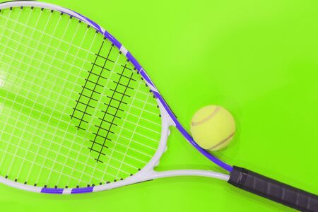 Tennis on a bright background, racket, ball, . Photographed in the Studio.