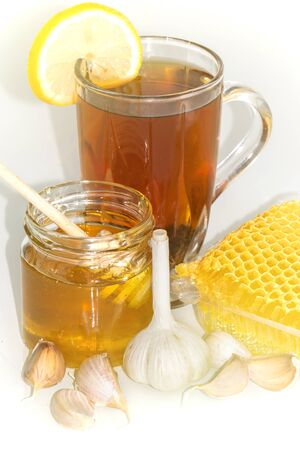 Tea with lemon and honey, garlic cloves. The honey in the comb