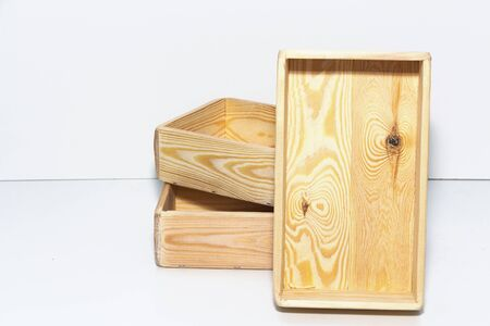 Empty wooden box on a light white background