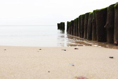 the breakwater on a calm beautiful sea. 写真素材
