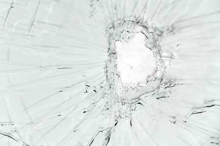 Broken glass, a background of cracked glass on a light background