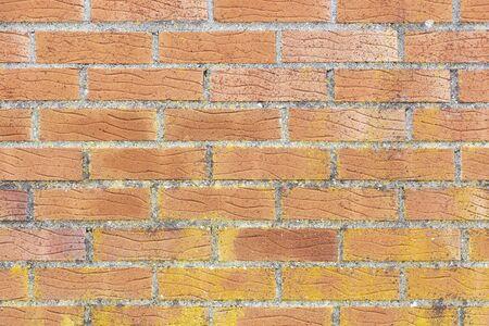 Brick wall. Laying bricks on mortar. The texture of the brickwork