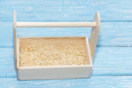 Empty wooden box. Made of pine, on a light white background. Banco de Imagens