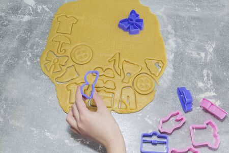 cookies, gingerbread in the form of clothing. Cooking process.