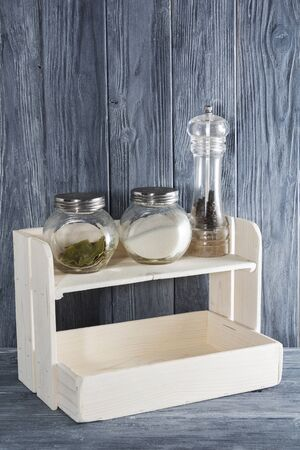 white shelf made of natural wood for spices in Provence style