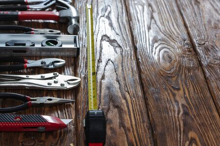 Close-up of hand tools on a wooden background. 스톡 콘텐츠