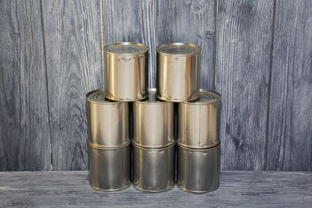 A number of closed metal sealed food cans, food supply, crisis