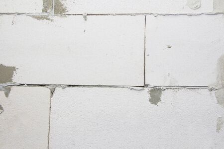 A Fragment Of A Modern Wall Made Of Gas Silicate Blocks. The process of laying blocks