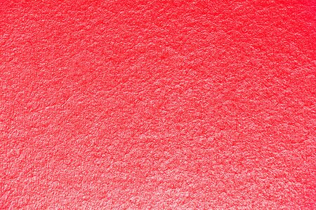 Close-up of red textures for the background. the light comes from below