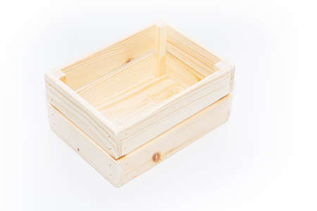 An empty wooden box. Made of pine and plywood, on a light white background