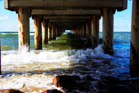 Waves rumble under the pier, and the wave rolls. Reklamní fotografie