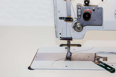 Industrial sewing machine. Clothing manufacturing, tailoring. Close up. Standard-Bild