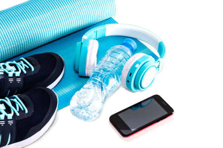 Yoga Mat, sports shoes, water bottle concept of healthy living, healthy eating, sports and diet Archivio Fotografico